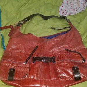Nice Tano bag ..like a rust color